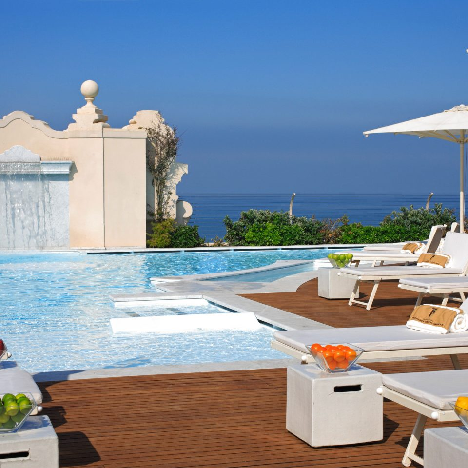 Beach Historic Pool Sea sky chair swimming pool property leisure Villa Resort house home condominium caribbean cottage outdoor structure mansion Deck set