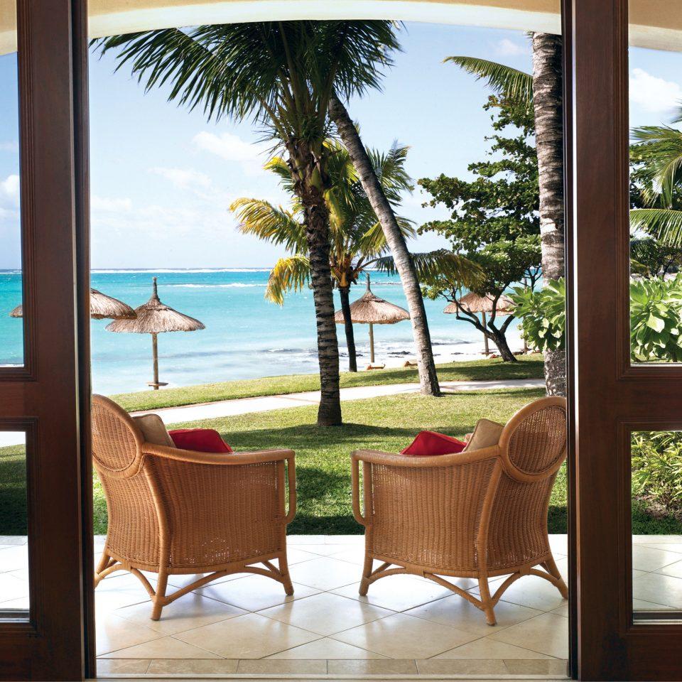 Beach Honeymoon Island Luxury Patio Romance Romantic Scenic views Tropical Waterfront tree water property Ocean home Resort overlooking Villa arecales porch Deck