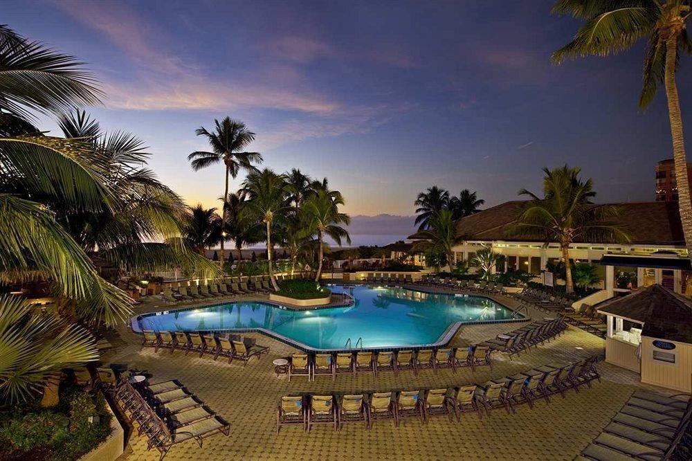 Deck Hot tub/Jacuzzi Outdoors Patio Pool Romantic Sunset tree palm swimming pool leisure Resort property Beach plant arecales lined caribbean Villa Lagoon condominium colorful