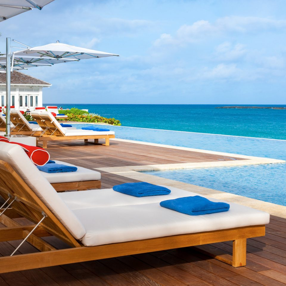 Hotels Romance Trip Ideas sky water chair leisure Beach property swimming pool caribbean Resort Ocean Sea Villa Deck