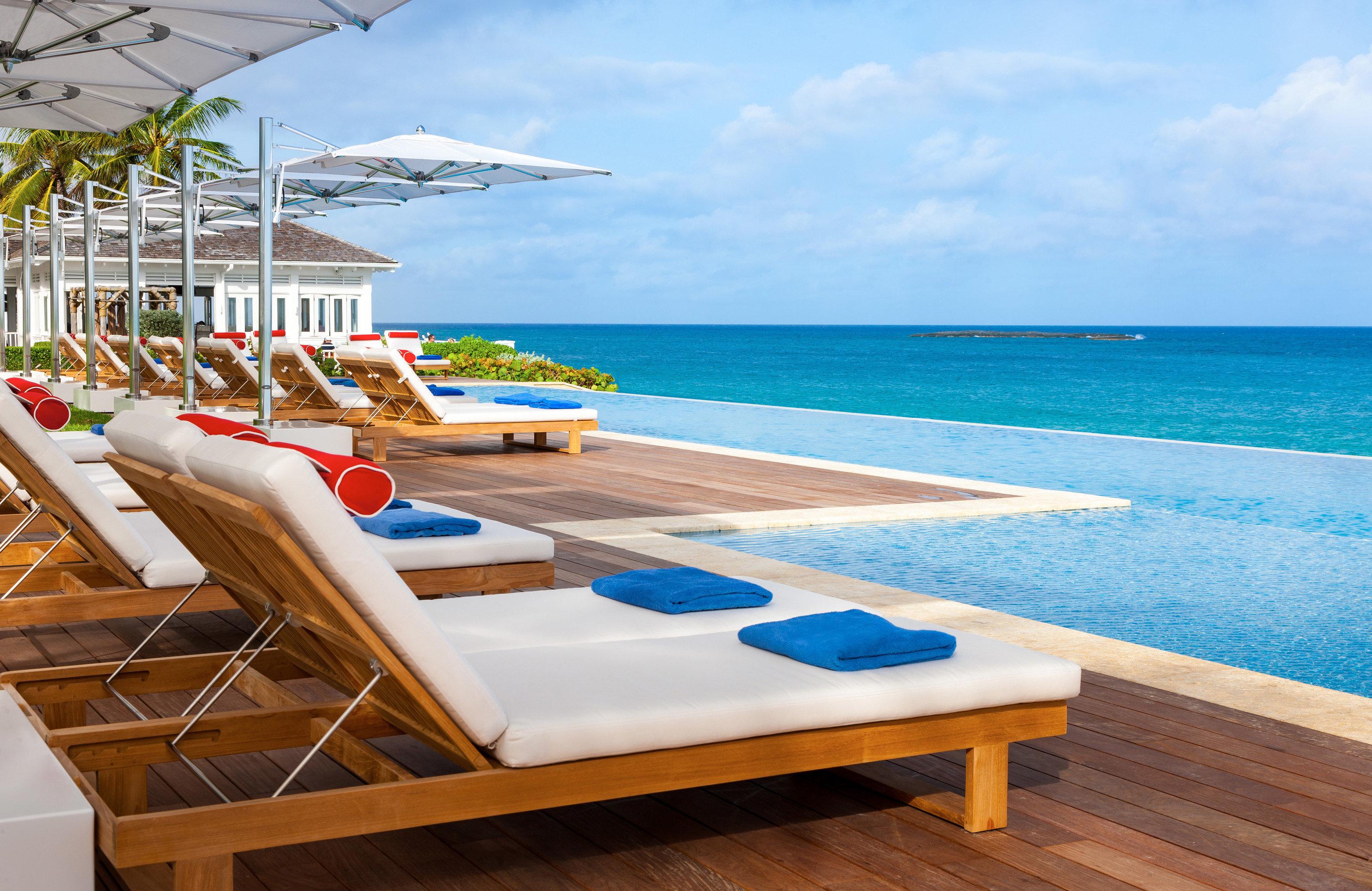 Hotels Romance Trip Ideas sky water chair leisure Beach property swimming pool caribbean Resort Ocean Sea Villa Deck