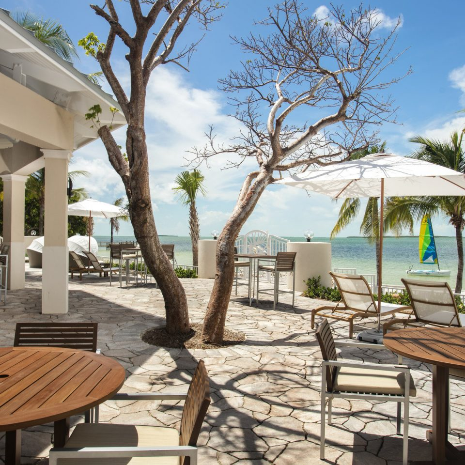 Hotels tree sky ground chair leisure property Resort home Villa Beach caribbean cottage backyard lawn porch Deck shade day