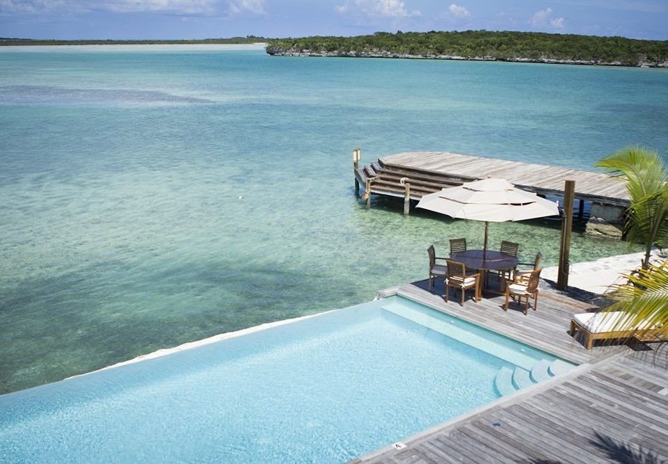 Deck Lounge Luxury Pool water sky swimming pool leisure Sea caribbean Ocean Nature Resort Lagoon Beach shore Lake Island vehicle overlooking