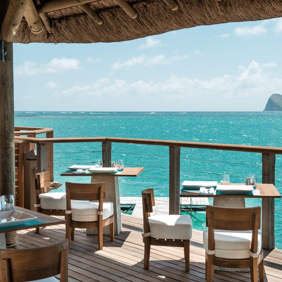 sky water chair leisure property Resort Ocean caribbean swimming pool Sea Villa Beach cottage overlooking shore Deck Island day