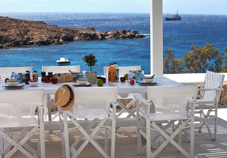water sky leisure property chair white restaurant Villa cottage Resort Beach home overlooking Deck shore Island