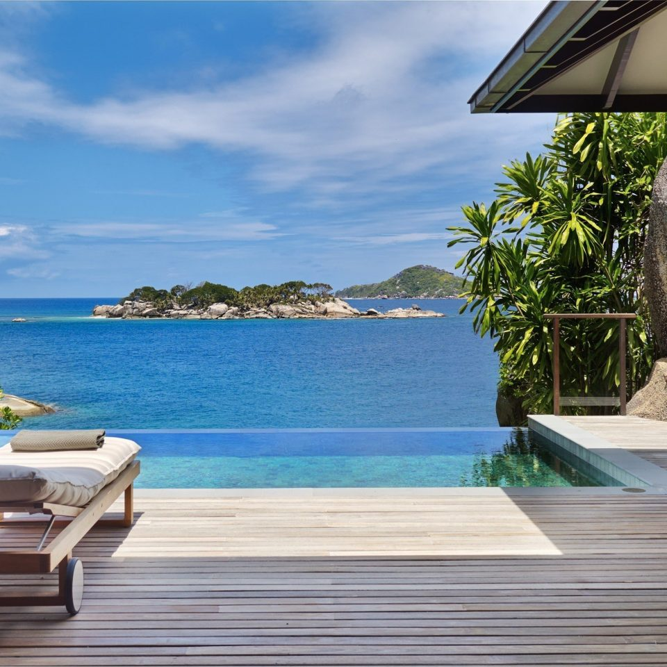 water chair building leisure property swimming pool Deck Resort Villa walkway porch caribbean cottage Beach backyard overlooking Island