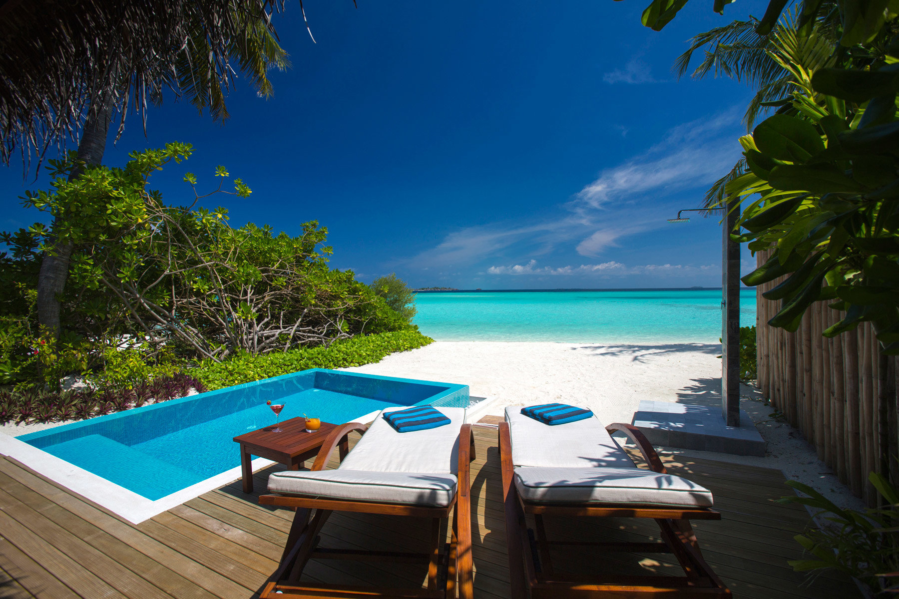 tree water swimming pool leisure Beach Ocean caribbean Sea Resort blue tropics Villa Lagoon overlooking lined Deck shade