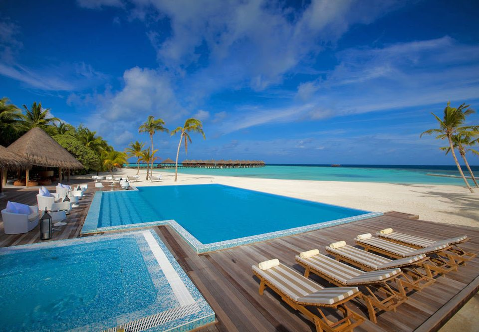 sky water swimming pool Beach chair leisure caribbean property Resort Pool Sea wooden Ocean Villa Lagoon resort town Deck swimming