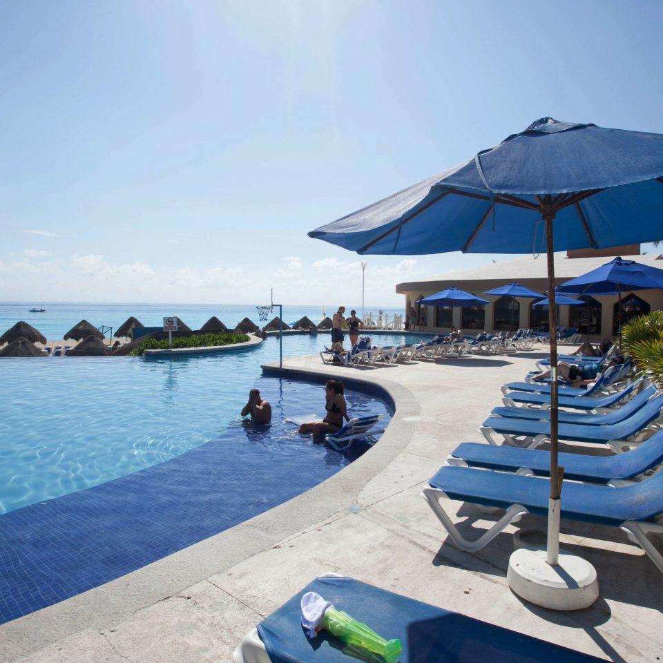 sky umbrella water ground chair leisure swimming pool Beach Resort Sea caribbean Ocean marina Pool blue dock Lagoon vehicle Water park swimming Deck shade shore sandy