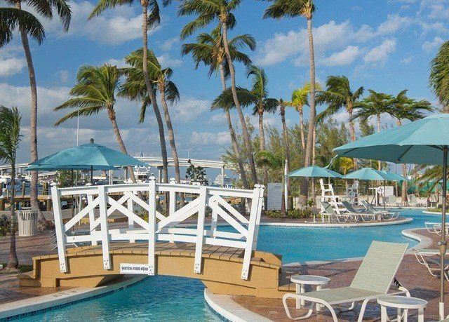 tree palm sky umbrella chair Resort Beach property caribbean leisure building swimming pool Pool marina Deck Lagoon resort town Villa dock condominium lined swimming shade