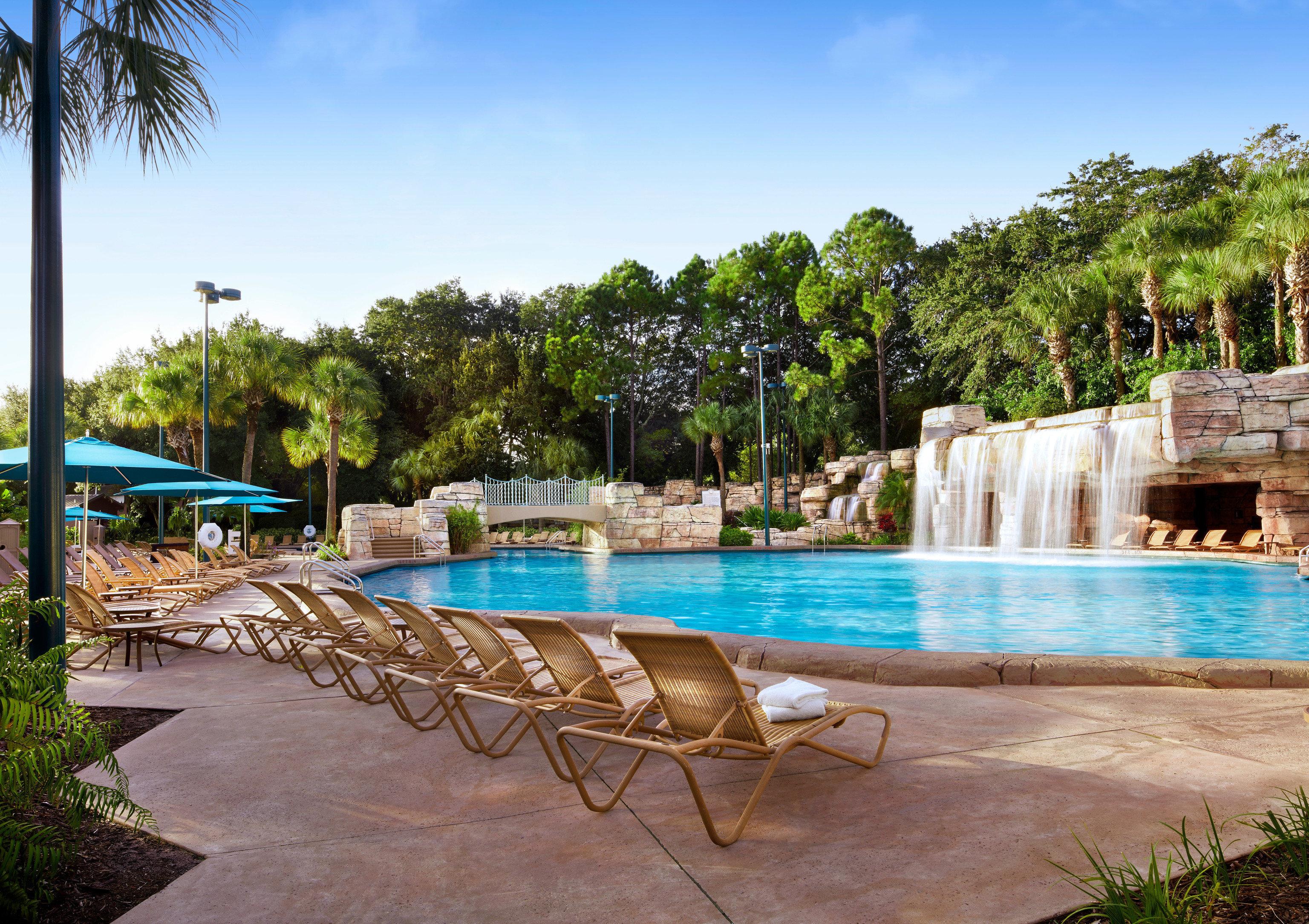 tree sky ground leisure swimming pool property Pool Resort palm Villa lawn Beach backyard caribbean hacienda condominium Lagoon lined Deck swimming sandy shade shore