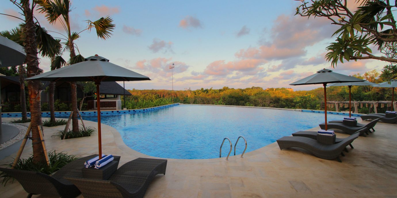 tree sky water property swimming pool Resort palm Beach Villa Sea shore Lagoon lined Deck shade sandy