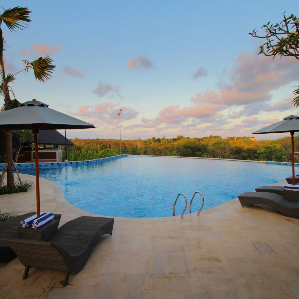 tree sky water property swimming pool Resort palm Beach Villa Sea shore Lagoon lined Deck shade sandy
