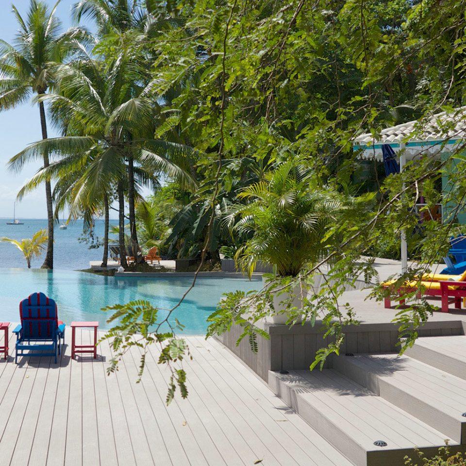 Lounge Play Pool Scenic views Waterfront tree leisure Resort Beach swimming pool walkway Water park Deck