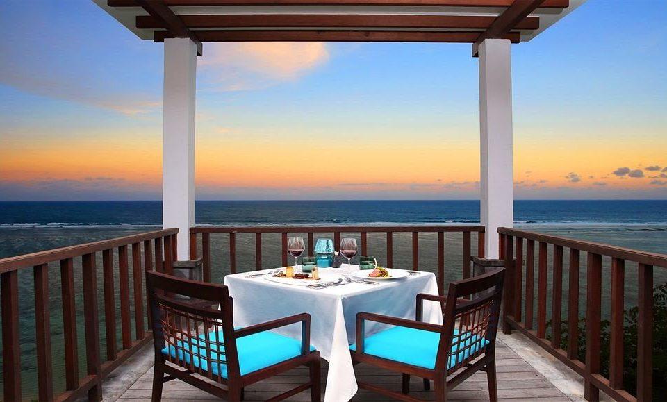 sky water pier Ocean chair overlooking property Resort scene caribbean Deck Beach Villa Sea porch set shore