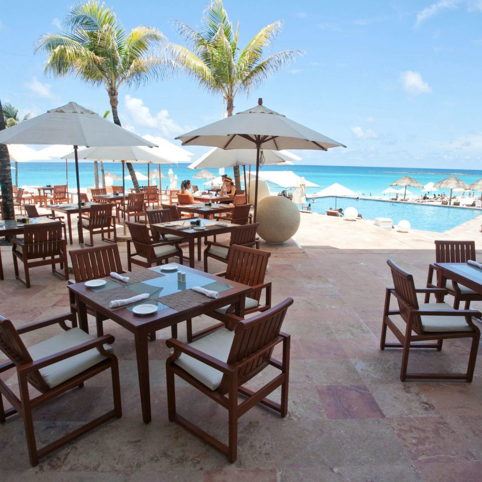 chair sky umbrella water leisure property Resort restaurant caribbean Ocean Villa Beach cottage Deck set swimming
