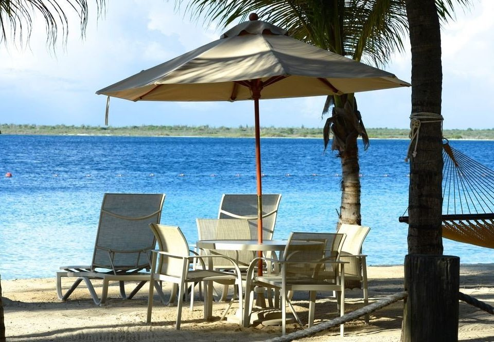 water sky chair umbrella tree Beach leisure lawn Ocean shade Resort Sea Villa caribbean lined facing cottage shore swimming palm overlooking day Deck
