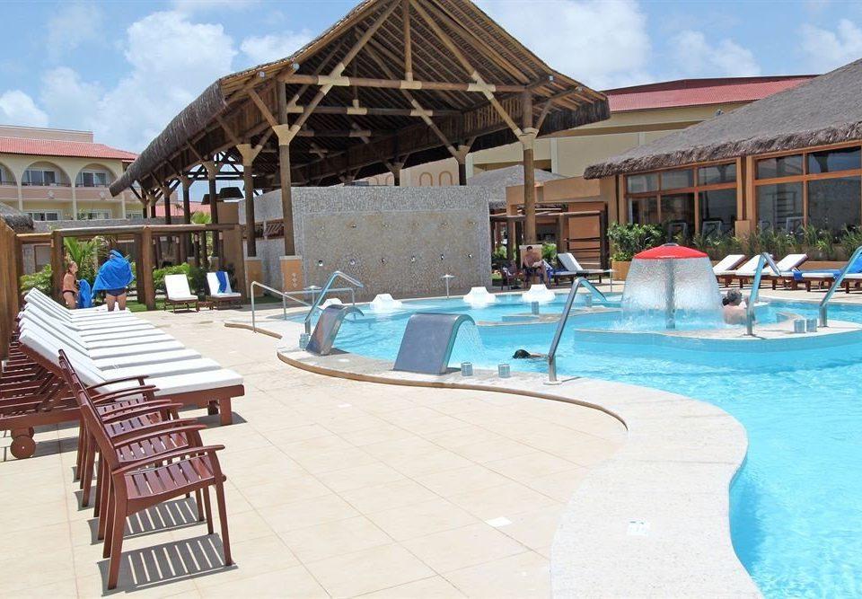 sky ground chair leisure swimming pool building property Resort Water park Pool Beach Villa Deck swimming