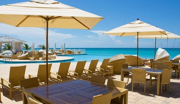 umbrella sky chair Resort property Deck leisure lawn resort town swimming pool Beach caribbean penthouse apartment restaurant shore lined empty