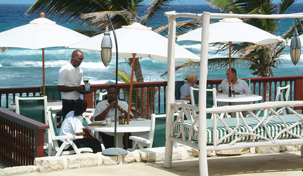 chair umbrella Deck Resort leisure lawn Beach caribbean porch outdoor structure outdoor furniture set shore shade day