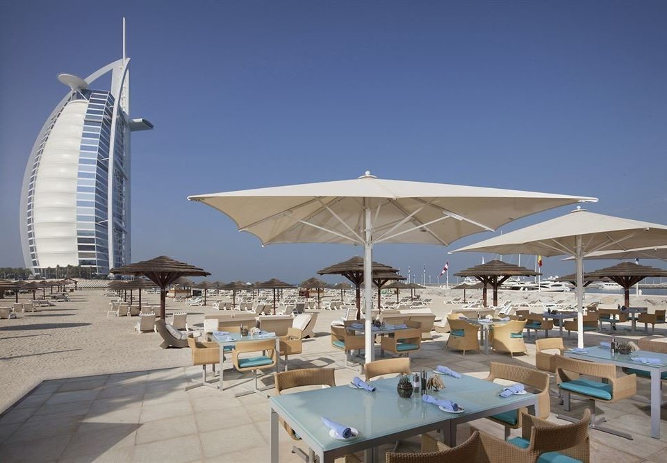 sky umbrella chair marina dock Beach vehicle Resort lawn Deck set shore day