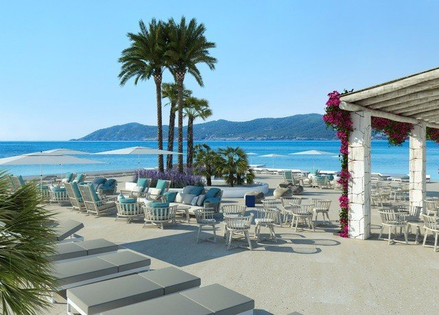 sky property leisure Resort Beach walkway marina condominium dock boardwalk Villa caribbean swimming pool Sea palm Deck overlooking shore