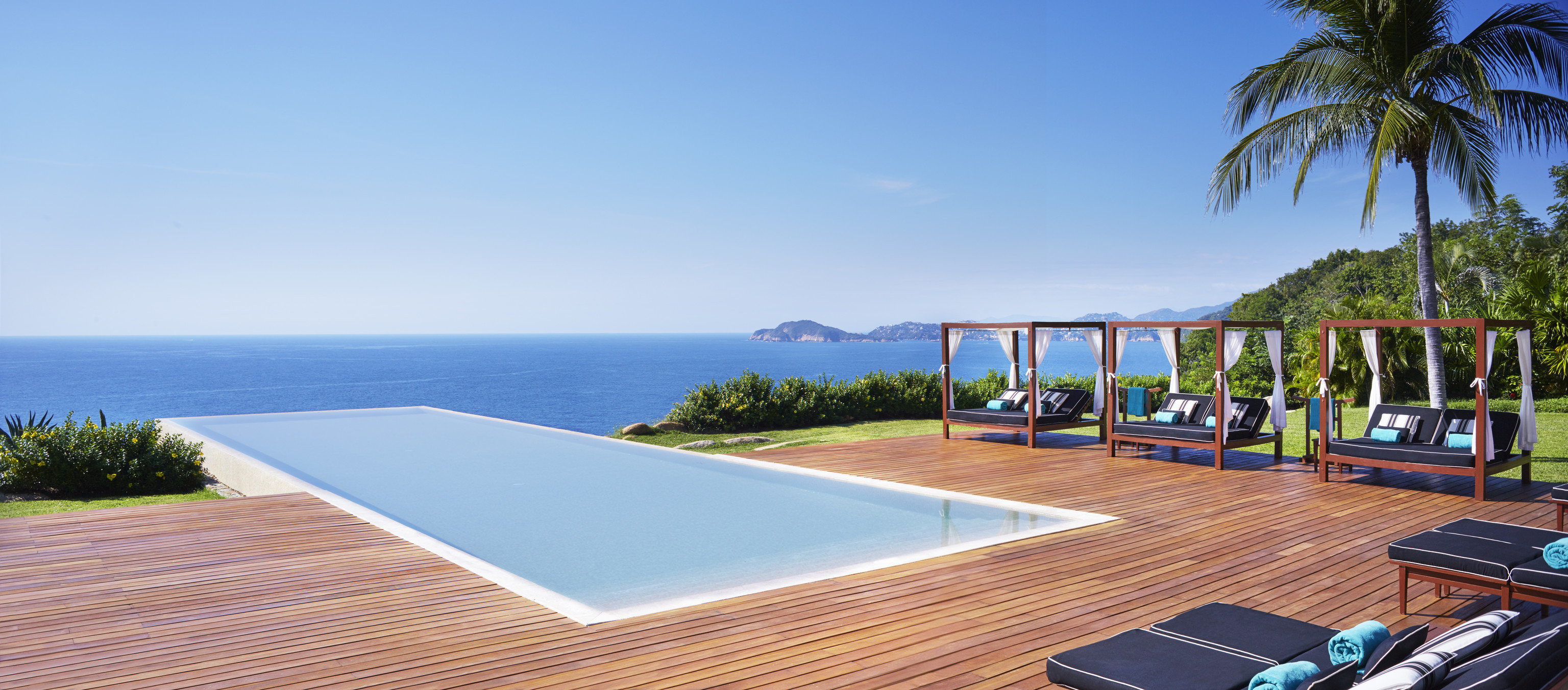sky water property leisure swimming pool Deck Resort Villa condominium caribbean walkway Beach dock Sea overlooking shore