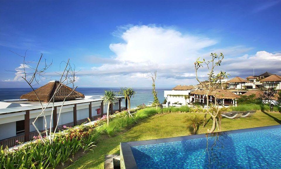 sky grass property Resort house marina swimming pool residential area dock Sea home Beach Villa Deck shore