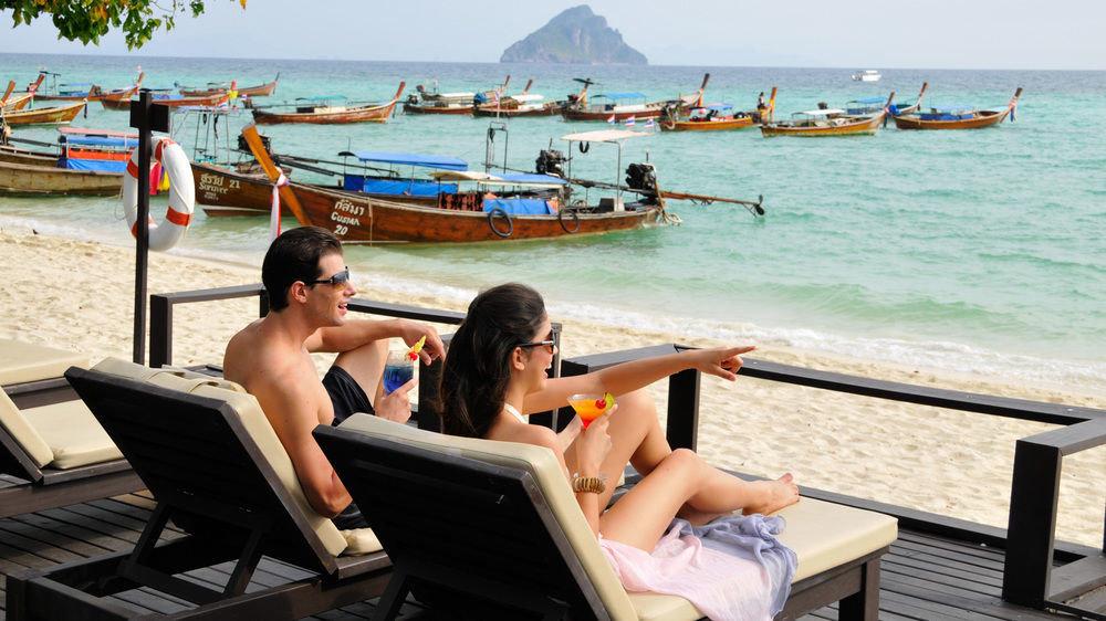 sky sitting water leisure ground sun tanning caribbean Beach Resort Sea vehicle boating Deck