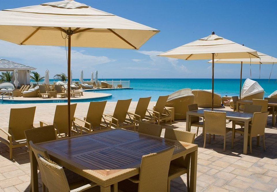 chair umbrella sky leisure property Resort lawn restaurant Villa Deck Beach swimming pool empty open set shore day