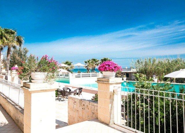 sky property leisure Resort building swimming pool Beach Villa home walkway caribbean condominium Deck