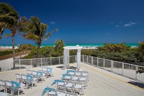 property swimming pool Resort building Deck condominium Beach walkway Villa marina caribbean dock boardwalk shore lined sandy