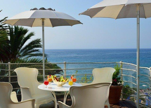 sky chair umbrella property caribbean Resort accessory Villa Beach restaurant cottage set Deck shade day