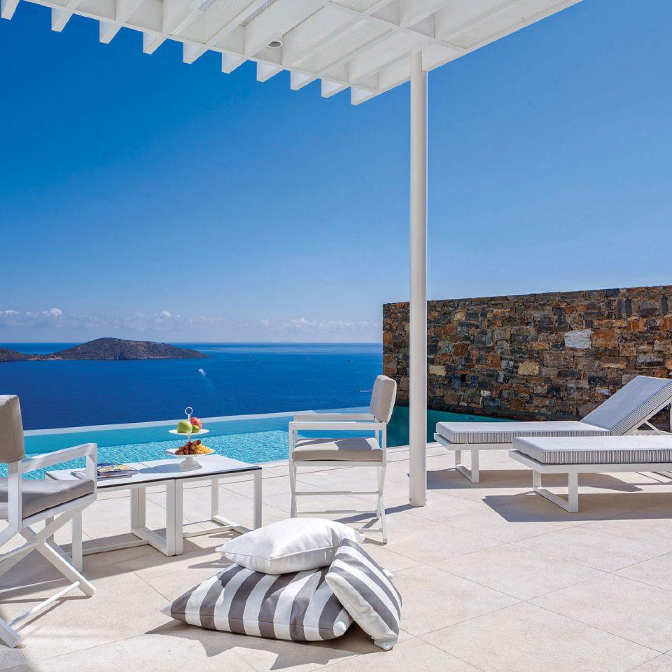 sky chair umbrella ground property leisure swimming pool Villa Resort Beach condominium shore Deck empty day sandy