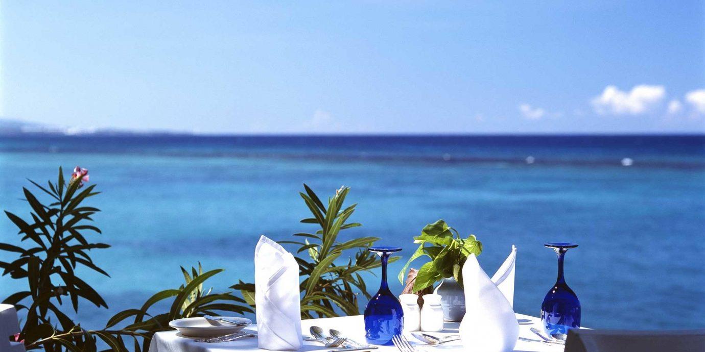 Dining Drink Eat Luxury Ocean Romantic Waterfront water sky caribbean swimming pool Beach Sea Resort overlooking Villa shore Island