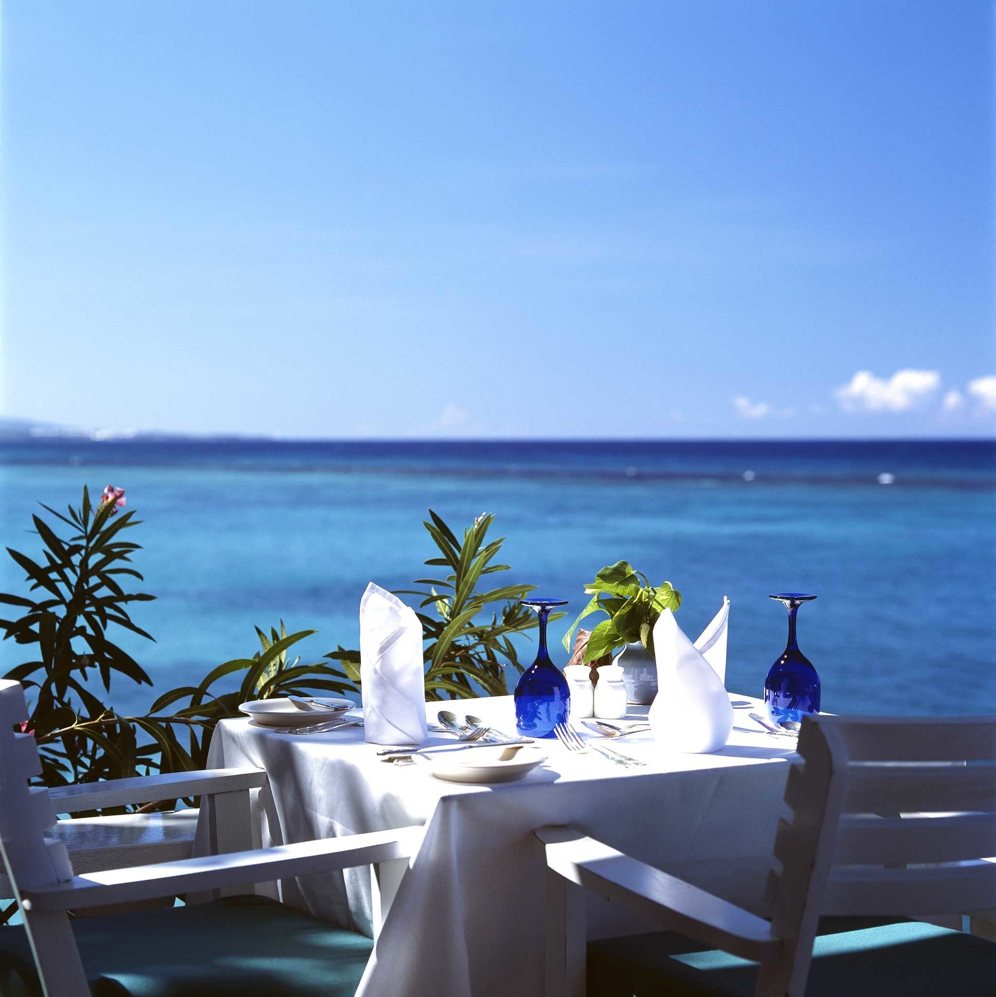 Dining Drink Eat Luxury Ocean Romantic Waterfront water sky caribbean swimming pool Beach Sea Resort overlooking Villa shore Island