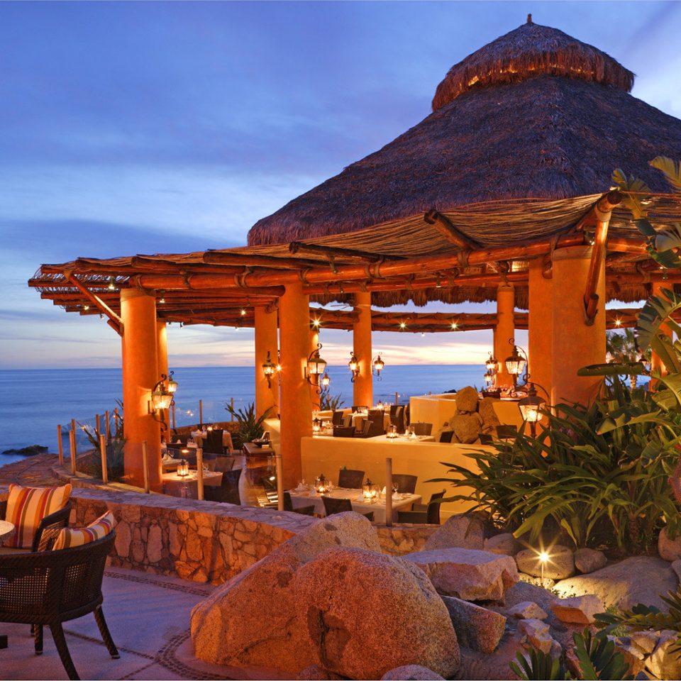 Dining Drink Eat Honeymoon Luxury Romance Romantic Scenic views Tropical Waterfront sky chair Resort Beach Villa set overlooking shade