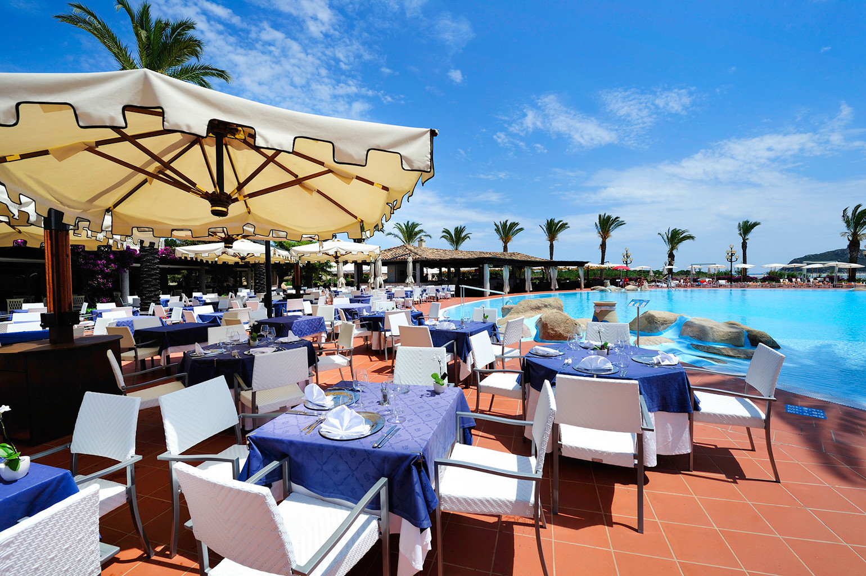 Beach Dining Family Outdoor Activities Play Pool Resort sky umbrella leisure chair restaurant swimming pool caribbean
