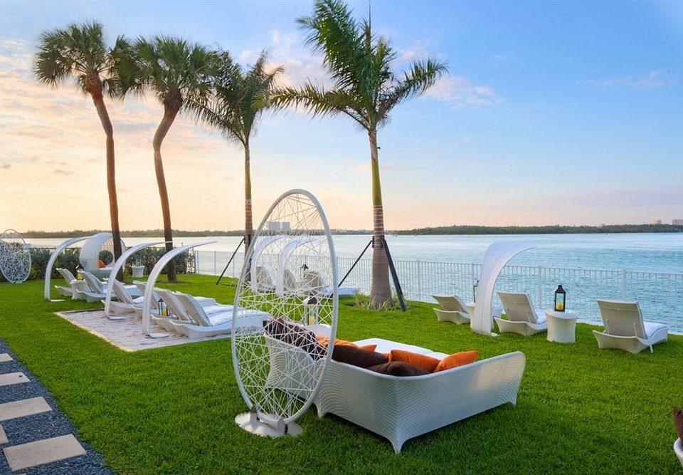 sky grass water property leisure Picnic Villa Lake swimming pool plant caribbean Resort tree Beach Drink palm overlooking