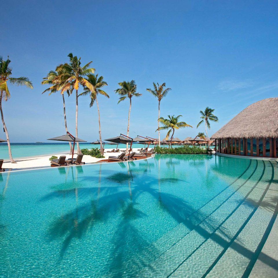 Elegant Lounge Luxury Modern Pool sky water swimming pool leisure property Resort caribbean Sea Ocean Lagoon Beach resort town palm shore blue swimming lined