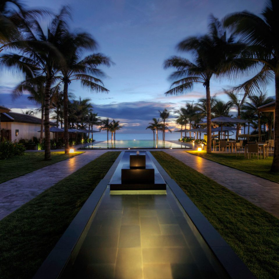 Beach Exterior Grounds Jungle Luxury Modern Ocean Pool Resort Sunset Tropical Waterfront sky tree grass night house evening home residential area lighting landscape lighting screenshot mansion dusk palm empty road lined