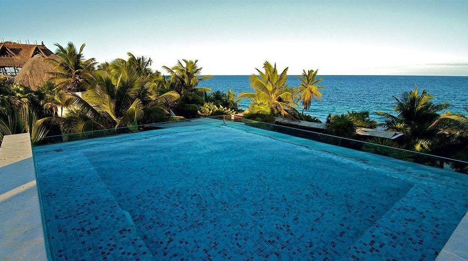 Exterior Hip Lounge Luxury Pool Tropical sky water swimming pool property Resort Beach Nature Ocean caribbean Villa Sea shore blue reef plant palm sandy