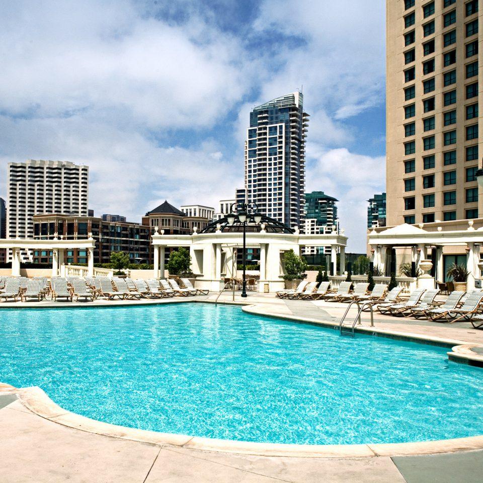 Exterior Lounge Pool water swimming Resort chair swimming pool property condominium leisure Beach building blue Island