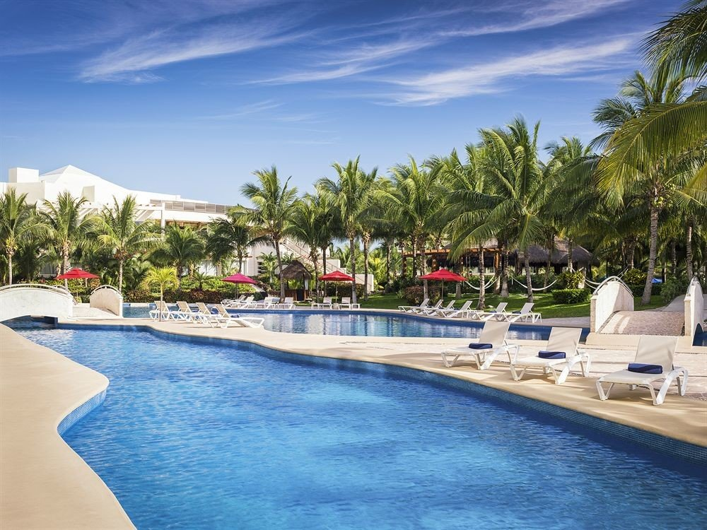 Exterior Lounge Luxury Modern Pool water tree sky swimming pool Resort leisure swimming caribbean Sea marina Nature Beach resort town Lagoon dock surrounded lined shore