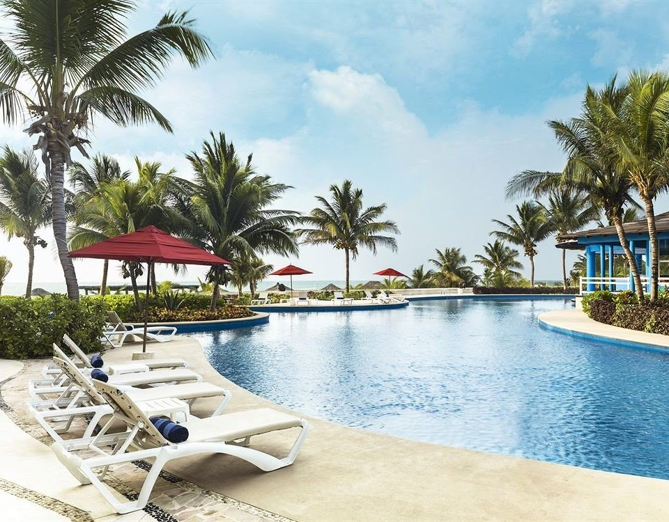 Exterior Lounge Luxury Modern Pool tree water Beach leisure swimming pool Resort property palm caribbean resort town Villa condominium Sea shore lined sandy