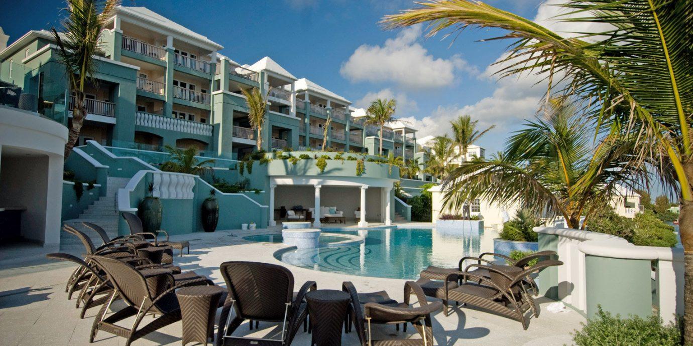 Exterior Lounge Pool Resort tree chair property condominium caribbean home Beach lawn Villa restaurant