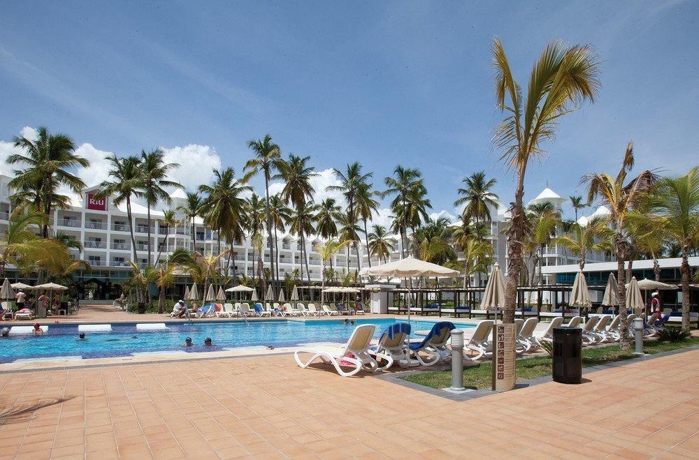 Exterior Lounge Pool Tropical sky tree ground palm property leisure Beach Resort marina swimming pool walkway dock boardwalk condominium arecales Sea caribbean shore sandy