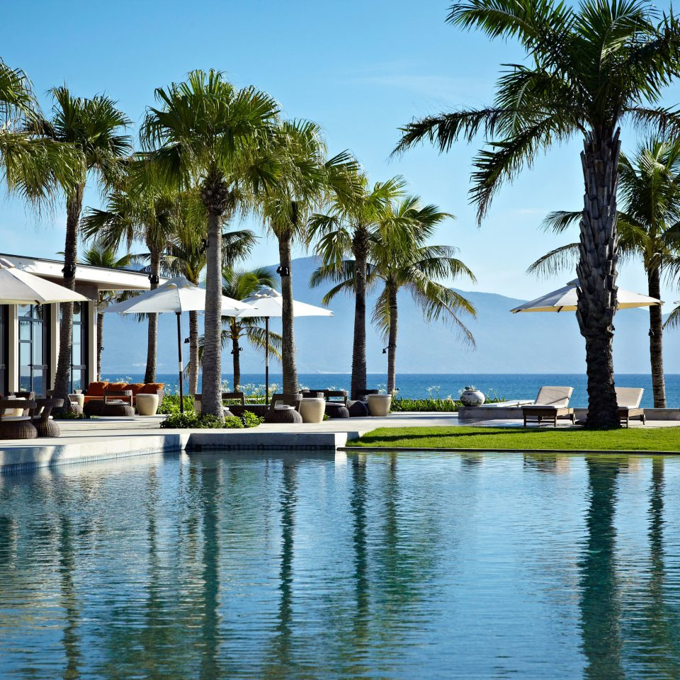 Family Modern Pool Resort tree sky palm leisure swimming pool arecales marina dock Ocean Sea Lagoon Beach caribbean lined