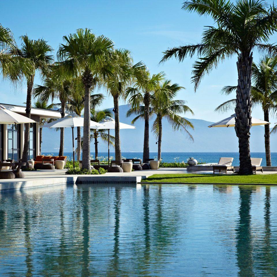 Family Modern Pool Resort tree sky palm leisure swimming pool arecales marina dock Ocean Sea Lagoon Beach caribbean lined