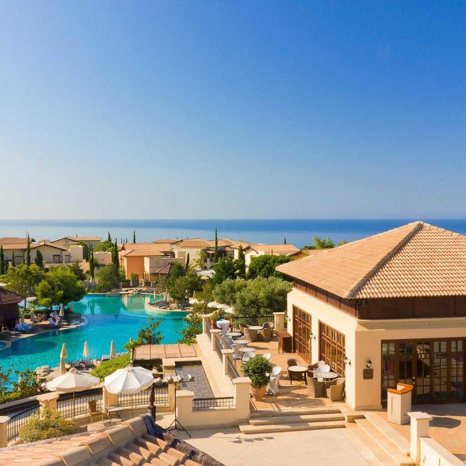 Family Luxury Pool Resort Scenic views Waterfront Wellness sky property leisure swimming pool Villa home condominium Beach